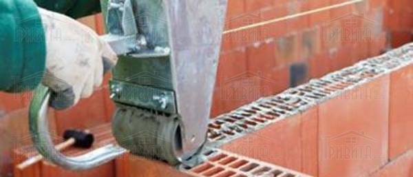 Фото 16. Какова технология зимней кладки стен облегченной конструкции?