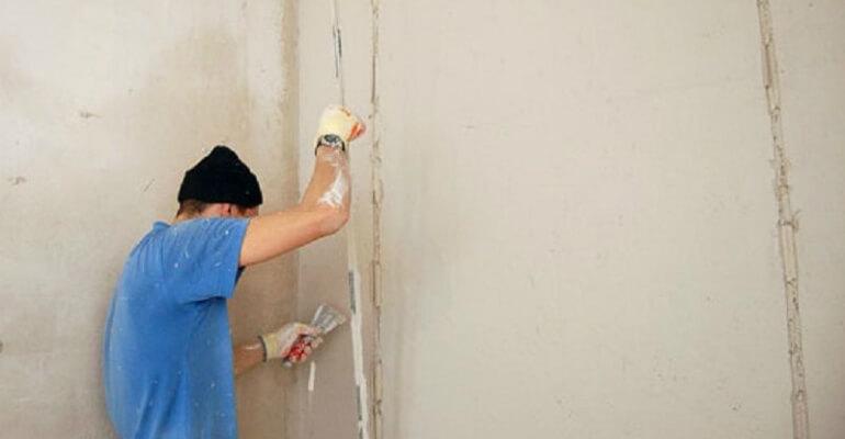Оштукатуривание внутренней стены